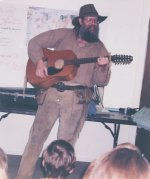 Mike entertains a class with an historical folksong.