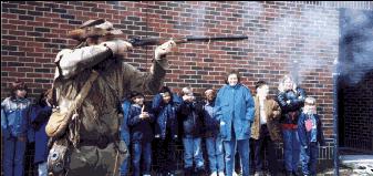 Blue Hawk demonstrates black-powder shooting.