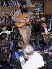 Mike shares a ballad with a class